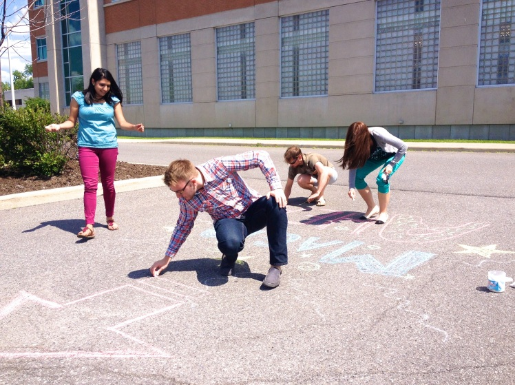 I brought in a bucket of sidewalk chalk and convinced my epi pals to spread some chalky joy on Friday afternoon. Here is a little taste of the magic.